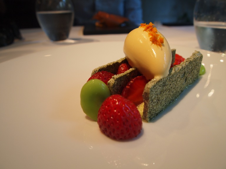 Green tea meringue with strawberries and fava beans